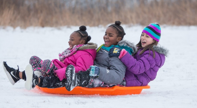 3 Girls sledding