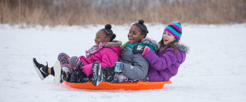 3 Girls sledding