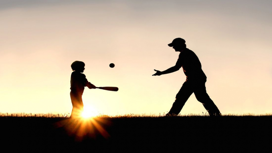 Adult and child playing catch